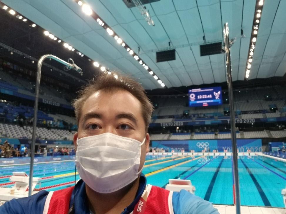 院長 吉岡範人(東京2020オリンピックの水泳競技会場にて)